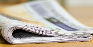 Selling newspaper